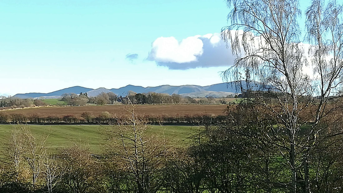 View of Lakeland fells from rear window of barn conversion properties.
